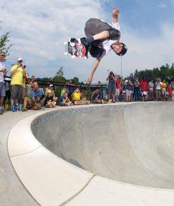 Tony Hawk doing a trick on a skateboard