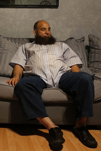 man sitting on his living room sofa